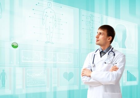 doctor computer: Young doctor in white uniform against technology background Stock Photo