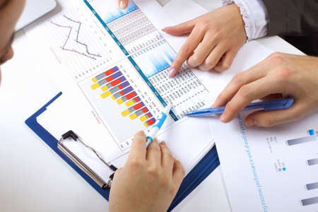 construction management: Financial paper charts and graphs on the table