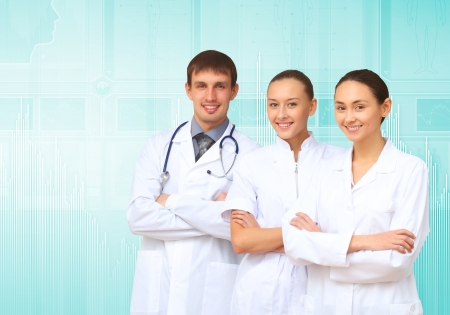 Young doctor in white uniform against technology background photo