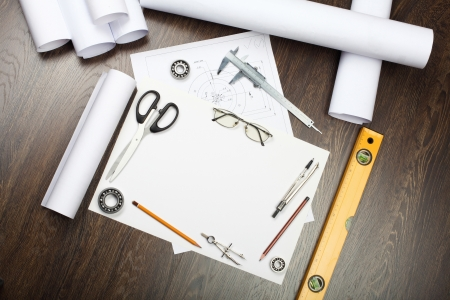 Tools and papers with sketches on the table photo