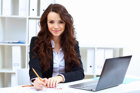 Young pretty business woman with notebook in the office Stock Photo - 14173969