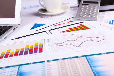 paperwork: Financial paper charts and graphs on the table