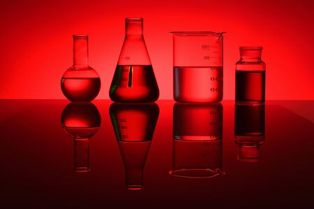 Glass chemistry tubes on a colour background Stock Photo - 14185202