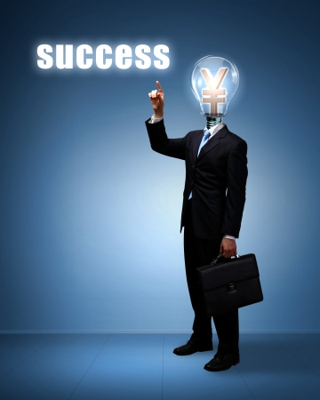 Light bulb and a business person as symbols of creativity in business Stock Photo - 14184293