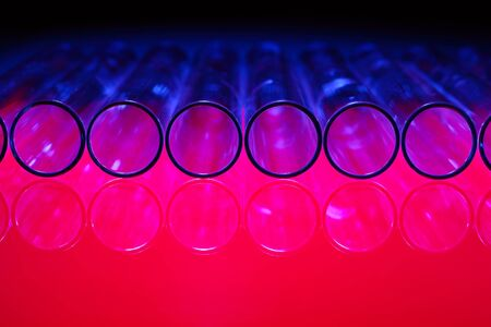 Glass chemistry tubes on a colour background Stock Photo - 14185197
