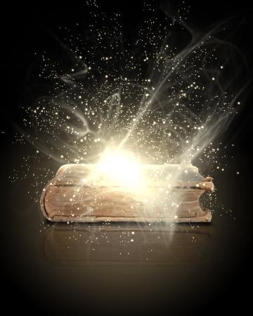 волшебный: Волшебная книга с свет, идущий изнутри он Фото со стока