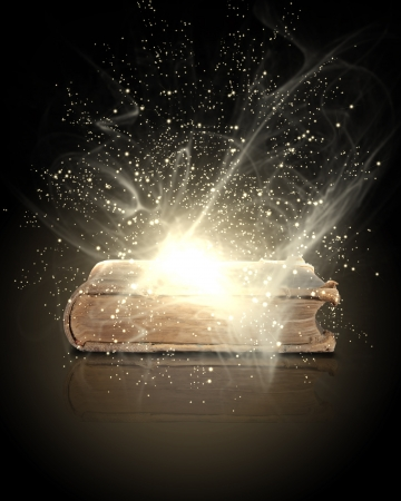 old diary: Magic book with light coming from inside it Stock Photo