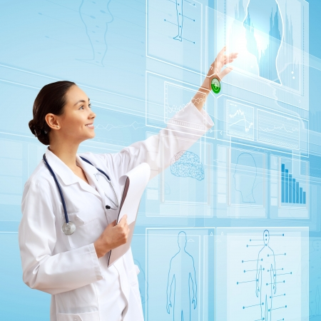 health technology: Young doctor in white uniform against technology background Stock Photo