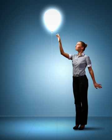 success: Light bulb and a business person as symbols of creativity in business