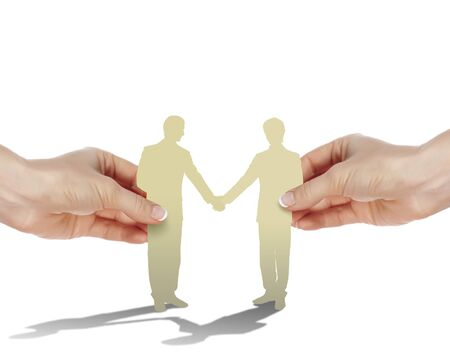 Two business people shaking hands as partners