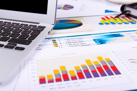 wealth management: Financial paper charts and graphs on the table