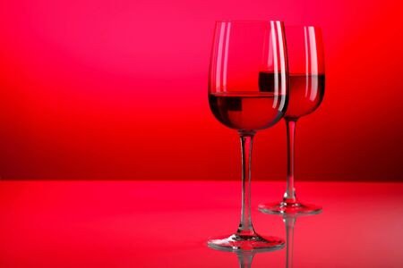 Glasses with wine on the color background photo