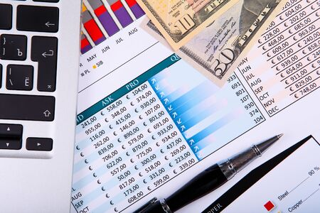 Financial paper charts and graphs on the table photo