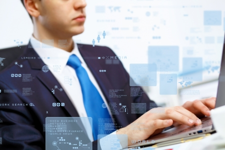 Business person working on computer against technology background photo