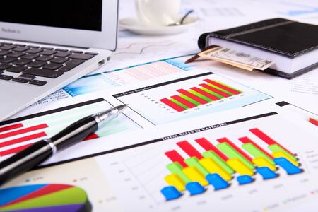construction management project: Financial paper charts and graphs on the table
