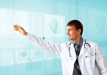 Young doctor in white uniform against technology background Stock Photo - 14522085