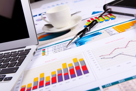 financial report: Financial paper charts and graphs on the table