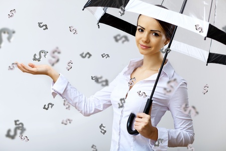 currency exchange: Collage with business woman under money rain with umbrella Stock Photo