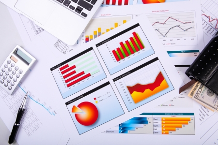 financial analysis: Financial paper charts and graphs on the table