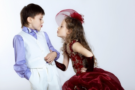 Portrait of a little boy and girl in beautiful dress