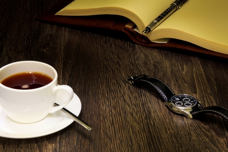 A cup of black coffee and a book Stock Photo - 14523028