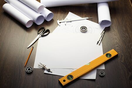 Tools and papers with sketches on the table Stock Photo - 14523024