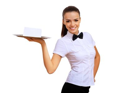 A young waitress in a white blouse with a tray in his hand photo