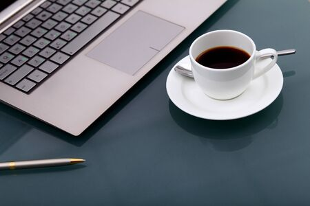 Image of business table with a cup of coffee and norebook Stock Photo - 14575314