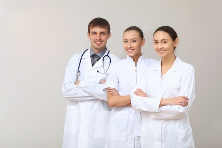 Team of three young doctors in white uniform Stock Photo - 14549858
