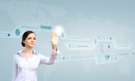 advance: Young woman in business wear working with digital touch screen Stock Photo