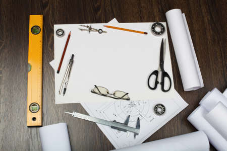 Tools and papers with sketches on the table Stock Photo - 14549953