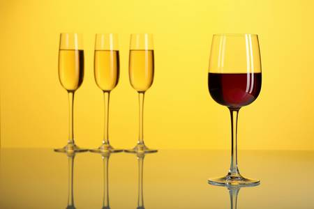 Glasses with wine on the color background Stock Photo