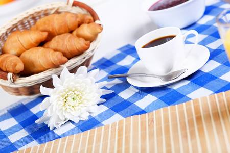 Continental breakfast with croisant and black coffee photo
