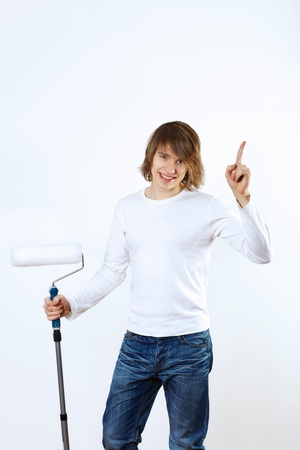 Portrait of young man with paint brushes Stock Photo - 14590872