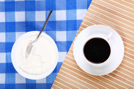 Continental breakfast with a cup of black coffee photo
