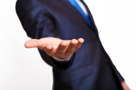 An empty hand of a businessman in blue suit Stock Photo - 14601710