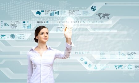 Young woman in business wear working with digital touch screen photo