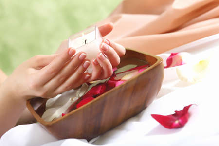 Female hands and manicure related objects in spa salon photo