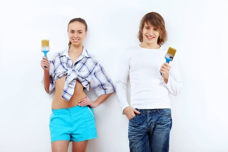 Portrait of young couple with paint brushes Stock Photo - 14609030