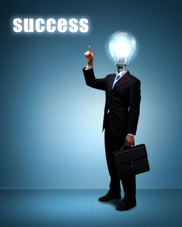 Light bulb and a business person as symbols of creativity in business Stock Photo - 14621972