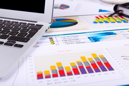 Financial paper charts and graphs on the table Stock Photo - 14622118