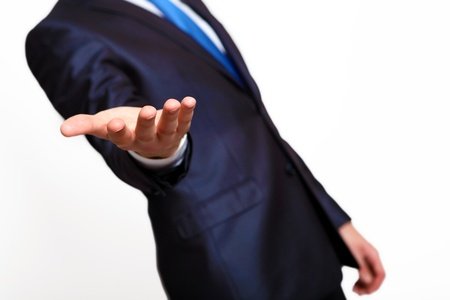 An empty hand of a businessman in blue suit Stock Photo - 14654590