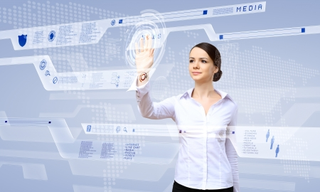 user interface: Young woman in business wear working with digital touch screen Stock Photo