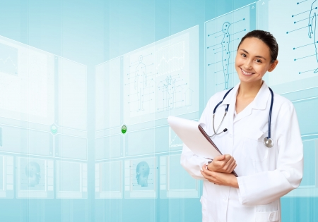 medical technology: Young doctor in white uniform against technology background Stock Photo