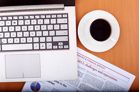 Image of business table with a cup of coffee and norebook photo