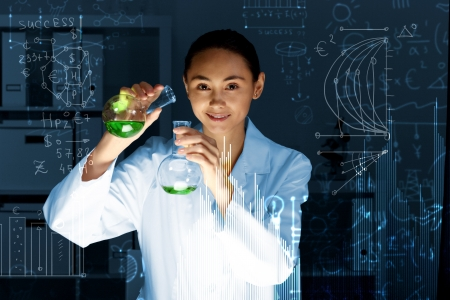 Young scientist in laboratory in white uniform photo