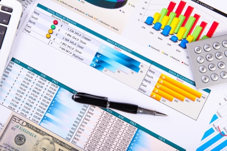 Financial paper charts and graphs on the table Stock Photo - 14654594
