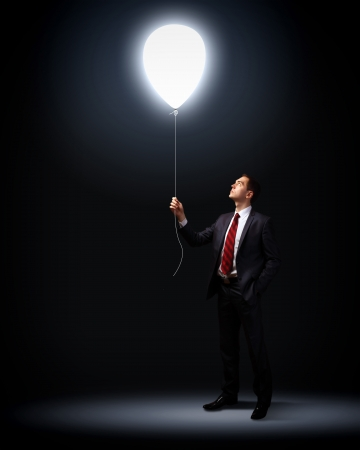 team success: Light bulb and a business person as symbols of creativity in business