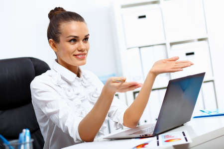 Young manager working with notebook in the office Stock Photo - 14730963