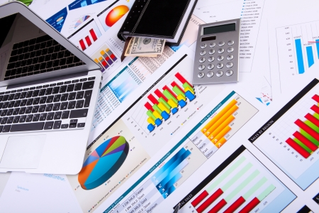 project management: Financial paper charts and graphs on the table